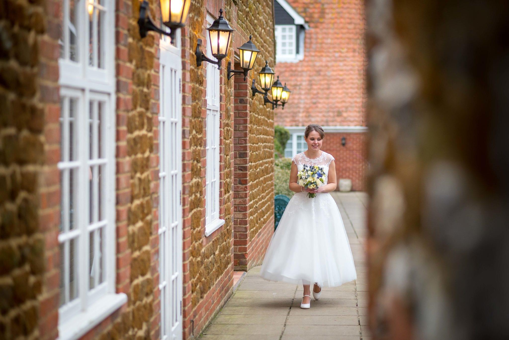 Bride walking Caley Hall Hotel